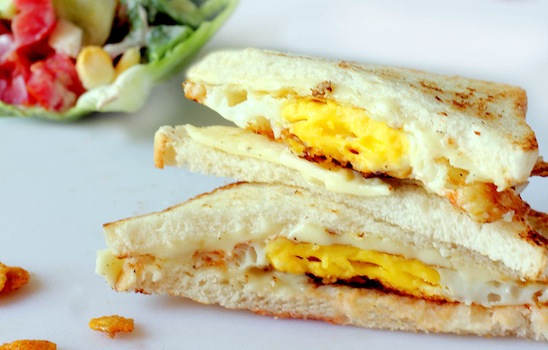 Monica's Indian Express: Fried Egg, Cheese and Chili Sauce sandwich